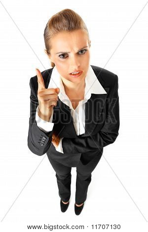 Full length portrait of strict modern business woman shaking her finger isolated on white