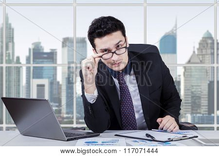 Businessperson Gaze At Camera In Office