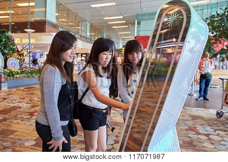 SINGAPORE - NOVEMBER 04, 2015: passengers at Changi Airport. Singapore Changi Airport, is the primary civilian airport for Singapore, and one of the largest transportation hubs in Southeast Asia