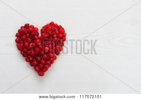 Red Current Berries In Heart Shape On Wooden Board