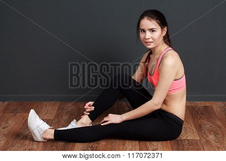 Fitness And Workout - Young Attractive Sporty Woman Smiling And Resting During Exercise