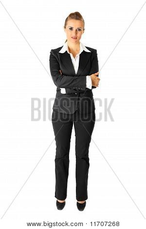Full length portrait of business woman with crossed arms on chest isolated on white