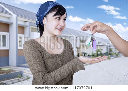 Happy Woman Getting Keys Of Her New House