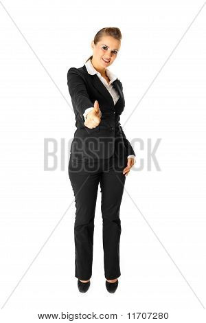 Full length portrait of smiling modern business woman showing thumbs up gesture isolated on white