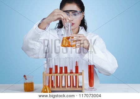 Indian Scientist Making Experiment