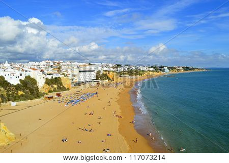 Albufeira, Algarve, Portugal - October 26, 2015 : People enjoying the sun on Albufeira Beach