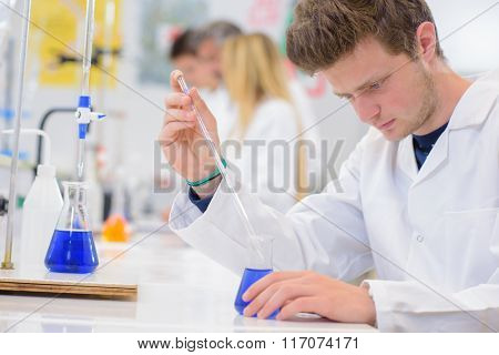young man experimenting in the lab