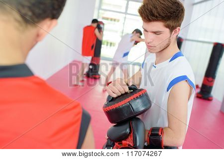young man with gloves