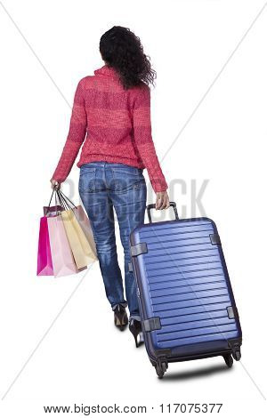 Woman Carrying Shopping Bags And Suitcase