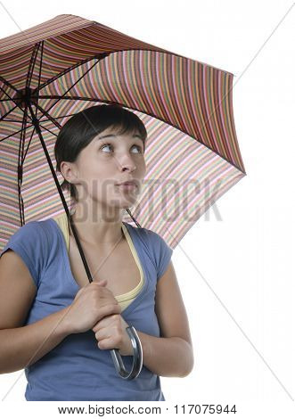 A pretty young girl holding an umbrella, isolated on white