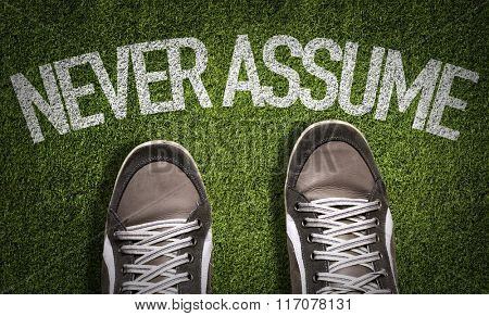 Top View of Sneakers on the grass with the text: Never Assume