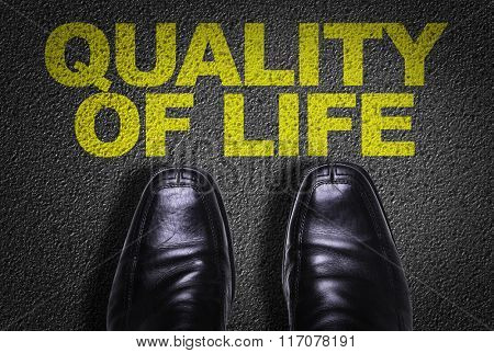 Top View of Business Shoes on the floor with the text: Quality of Life