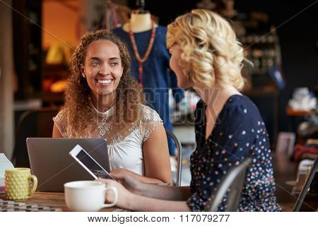 Fashion Designers In Meeting Using Laptop And Digital Tablet