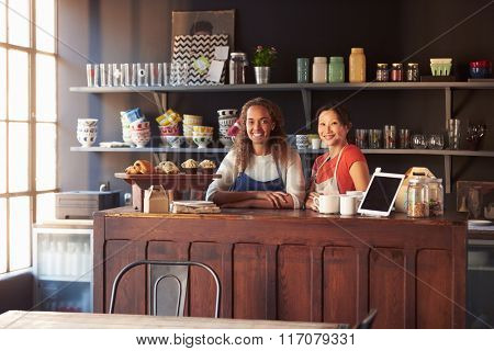 Two Female Coffee Shop Owners Standing Behind Counter