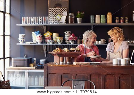 Staff At Coffee Shop Standing Behind Counter