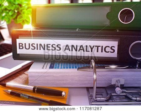 Business Analytics on Black Office Folder. Toned Image.