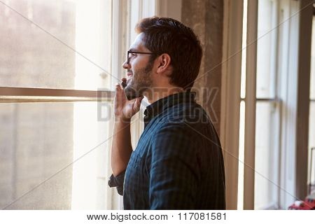 Businessman On Mobile Phone In Office
