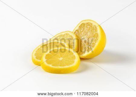 sliced fresh lemon on white background