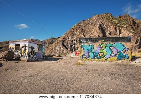 Abandoned buildings with painted walls
