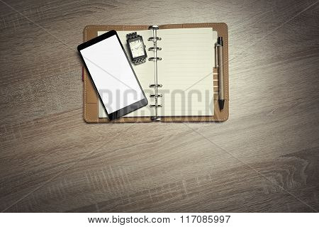 Office still-life and smartphone.