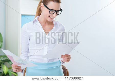 Overjoyed woman holding papers
