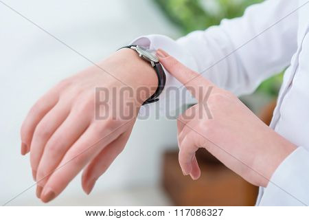 Busy woman looking at her wrist watch
