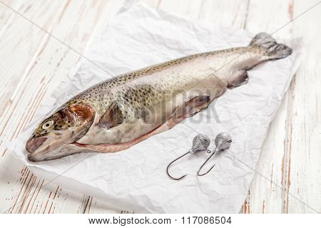 Fresh trout on white wood