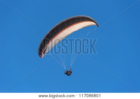 Unidentified pilot flying with a paraglider