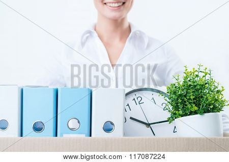 Pleasant woman holding box with things
