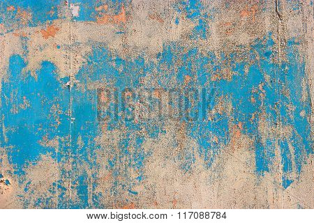 Old peeled paint and dirt on old blue wooden wall