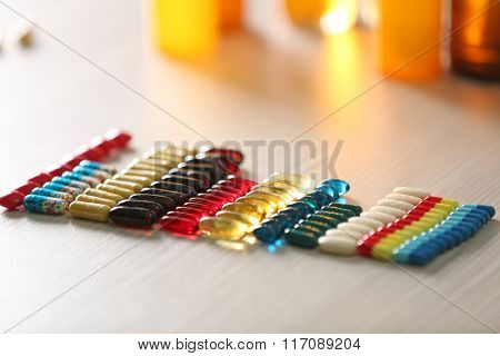 Colourful drugs in a row on the table, close up