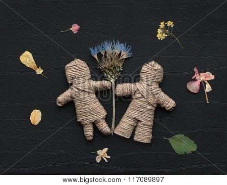 Boy And Girl Are Made Of Hemp Rope Holding Flowers. Be My Valentine Forever. Floral Fireworks Around