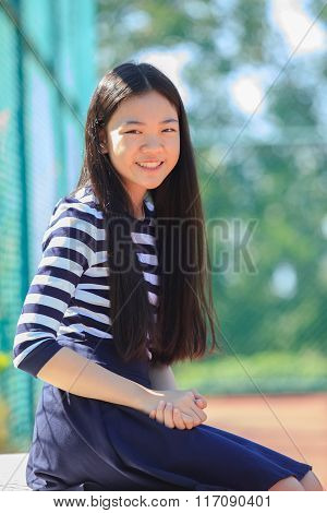 Portrait Happy Face Of Asian Girl Toothy Smiling Happiness Emotion In Outdoor Sport Field