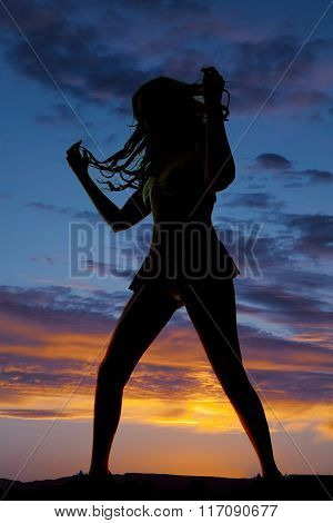 Silhouette Of Woman In Short Skirt Play With Hair