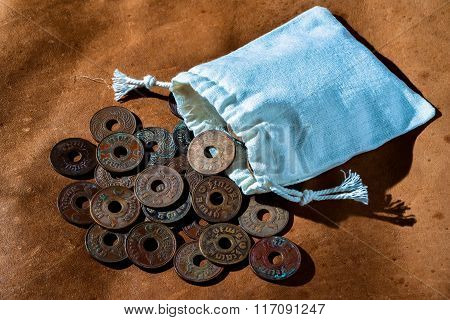 Pile Of Old Ancient Coins Of Thailand And Money bag