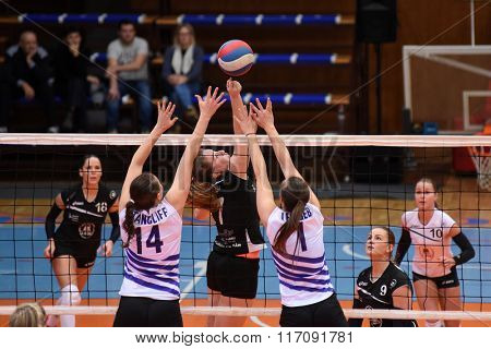 KAPOSVAR, HUNGARY - JANUARY 17: Andrea Jenei (black 7) in action at the Hungarian I. League volleyball game Kaposvar (black) vs Ujpest (white), January 17, 2016 in Kaposvar, Hungary.