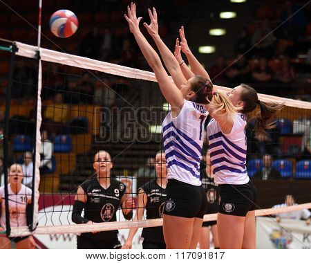 KAPOSVAR, HUNGARY - JANUARY 17: Nevena Iricanin (white 7) blocks the ball at the Hungarian I. League volleyball game Kaposvar (black) vs Ujpest (white), January 17, 2016 in Kaposvar, Hungary.