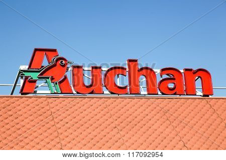 Auchan logo on a roof