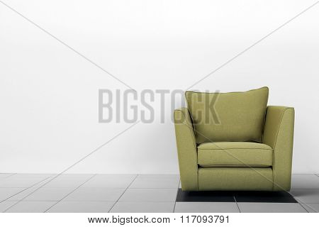 Living room interior with green armchair on white wall background