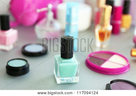 Nail polish with makeup cosmetics on a table