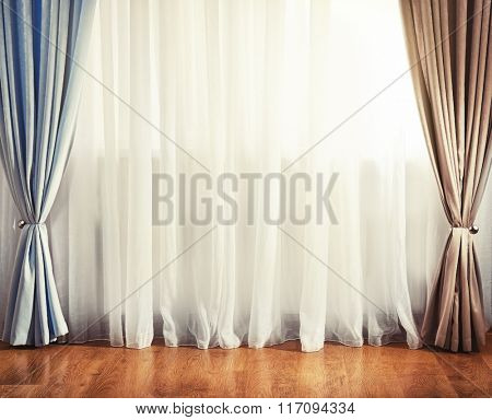 Empty room with curtain and window