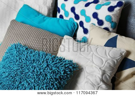 Decorative pillows on grey background, close-up