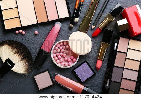 Cosmetics on dark background, closeup