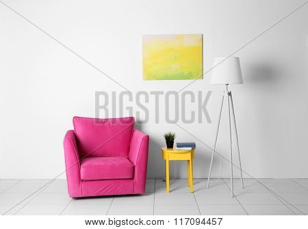 Living room interior with pink armchair, lamp and yellow chair  on white wall background