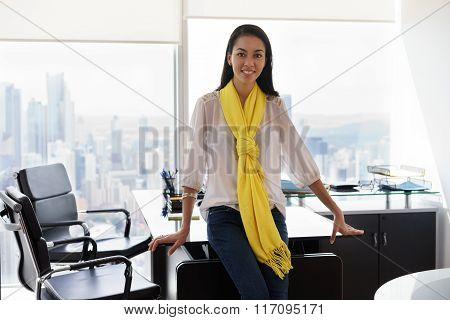 Portrait Of Young Woman Ceo Smiling In Business Office