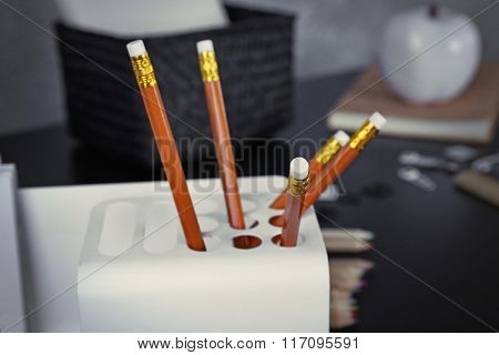Set of pencils in office case on a table