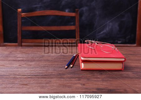 Books and school accessories on wooden table