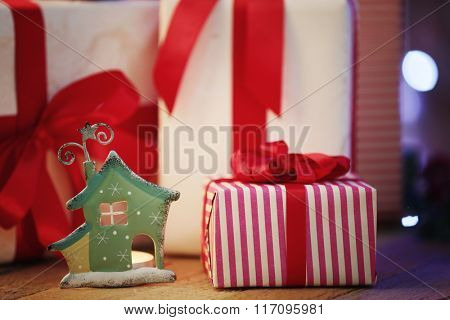 Christmas gift boxes on the wooden table, close-up