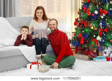Christmas family portrait in home holiday living room