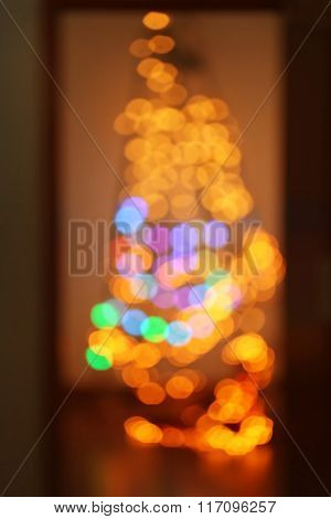 Blurred electric garland on a leader over wall background